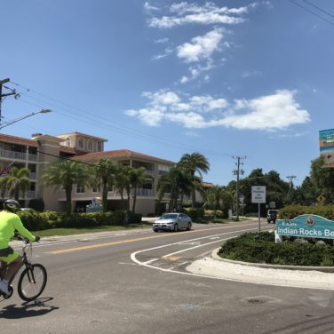 A man rides a bicycle on Gulf Blvd in Indian Rocks Beach