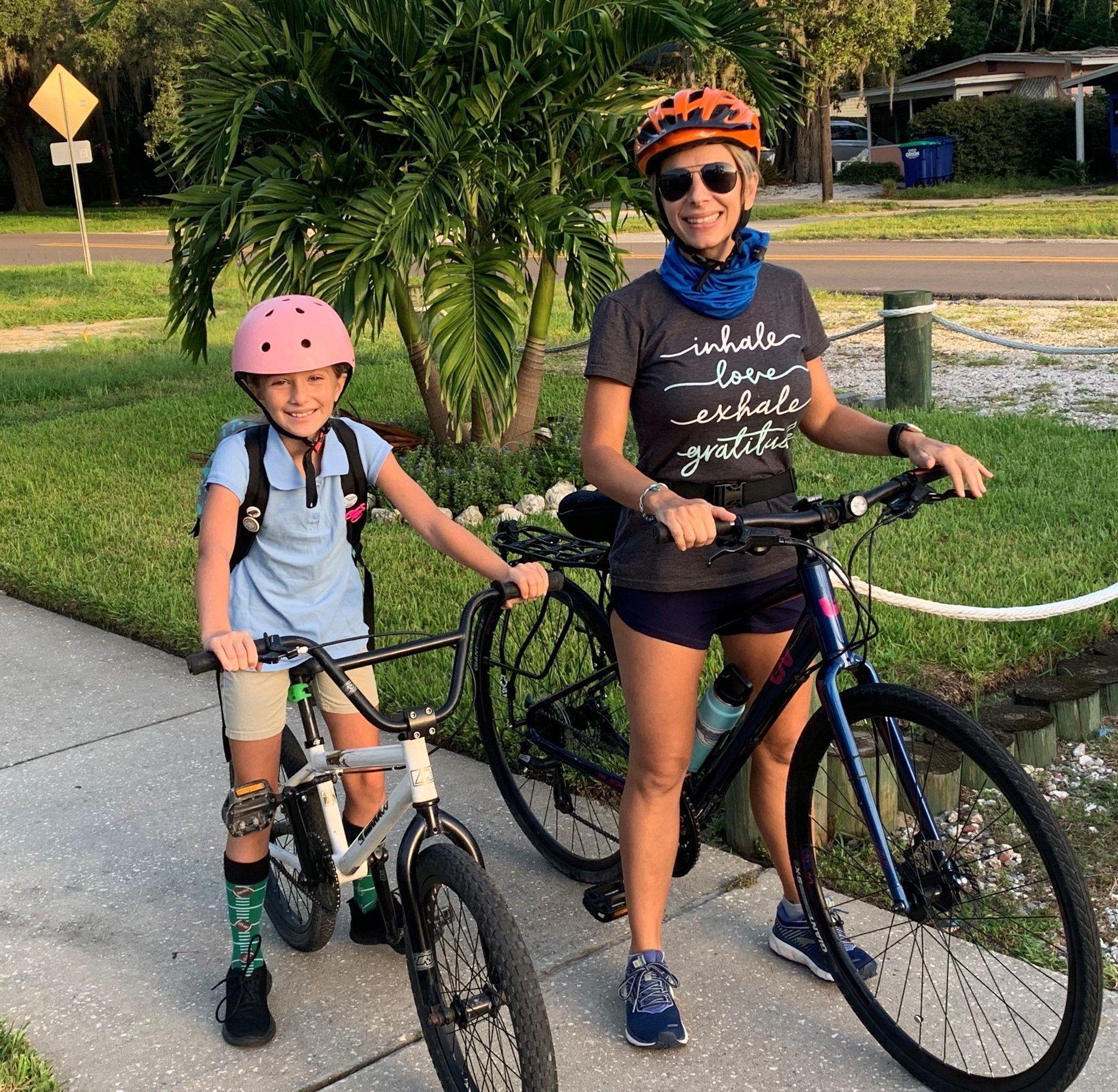 Angela and child on bikes